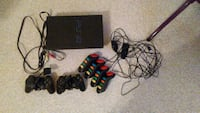 PlayStation 2 with 4 game controllers & two contro