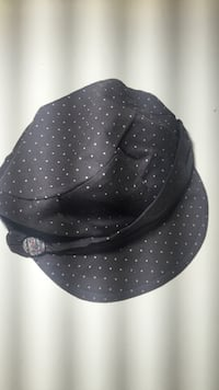 white and black polka-dot cap