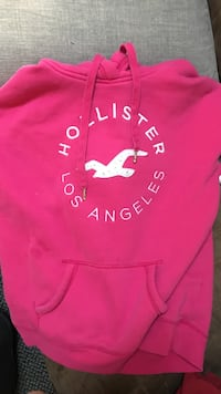 red and white Hollister pullover hoodie