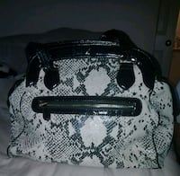 gray and black leather handbag 16 km