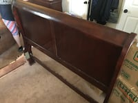 Brown wooden bed headboard and footboard Tomball, 77375