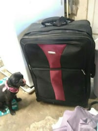 black and red soft side luggage 2276 mi