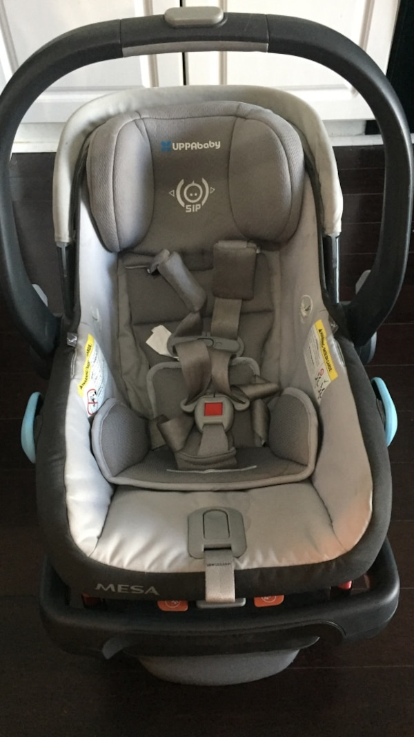 baby's gray and black car seat carrier
