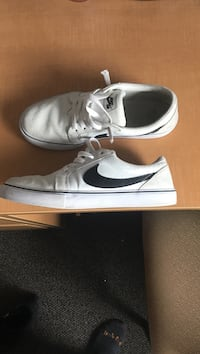 white-and-black Nike SB suede shoes