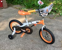 Toddler's bicycle with training wheels in orange and white  Welland, L3C 4N4