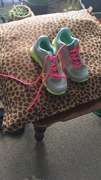grey-and-green running shoes