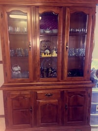 brown wooden framed glass china cabinet Calgary