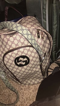 Brown and black gucci backpack Charlotte, 28262