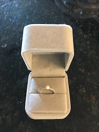 Silver-colored clear gemstone ring with box
