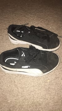 Pair of black-and-white puma low-top sneakers