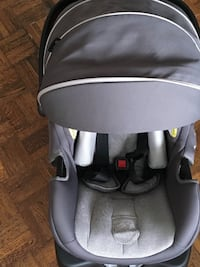 Baby's grey and black carrier car seat