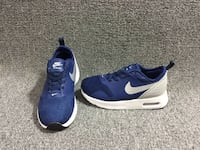 pair of blue-and-white Nike running shoes Silver Spring, 20901