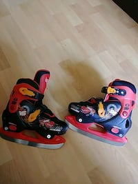 pair of red-and-black inline skates Mississauga, L4Z 1H6
