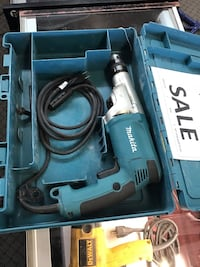 black and blue Makita corded power tool in case Denver, 80204