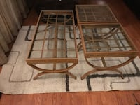 several clear glass panel side tables with brown wooden frames