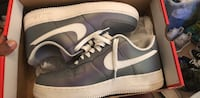 Pair of gray-and-white nike sneakers