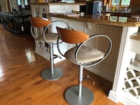 Two stainless steel base brown leather padded bar stools 538 km