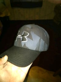 gray and black Under Armour cap Newport, 37821