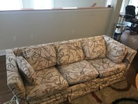 brown and beige floral 3-seat sofa