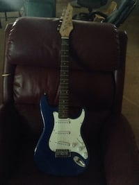 blue, black, white, and brown electric guitar Lancaster, 93534