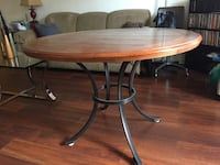 round brown wooden table with four chairs dining set Arlington, 22204