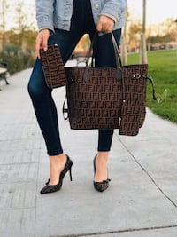 monogrammed brown-and-black heeled shoes Calgary, T3R 0X4