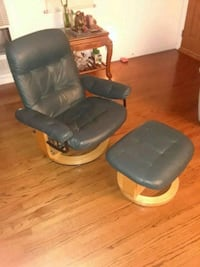Green reclining chair with footrest