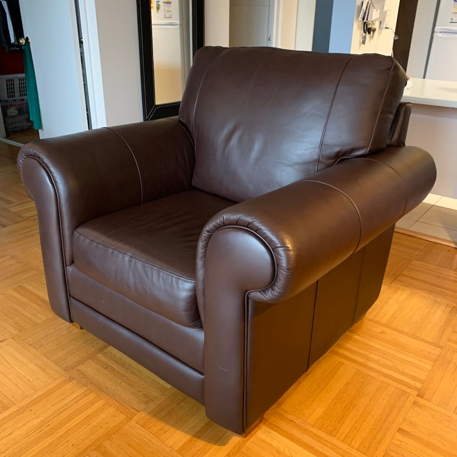 Leather chair with rolled arms