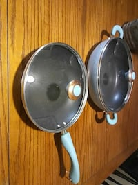 gray steel lidded cooking pots