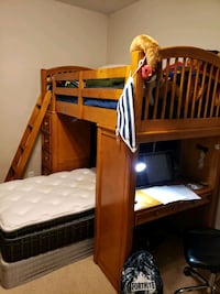 brown wooden bunk bed with white mattress Houston, 77077
