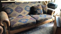 Three seater sofa with leather arms excellent condition. Ready to go today   Toronto, M4M 1C7