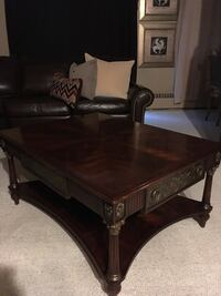 Theodore Alexander coffee table mahogany top surface carved metal accents 2 side drawers has couple of nicks in good condition Oakville, L6K 1Y8