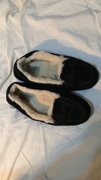 Pair of black-and-white slip on shoes