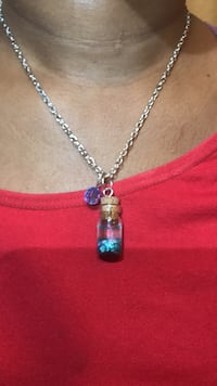 silver-colored necklace with blue gemstone pendant 1268 mi