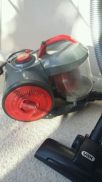 gray and red canister vacuum cleaner 5949 km