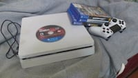 white Sony PS4 console with controller and game ca