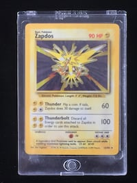 Rare Holo Zaptos Pokémon Card with Hard Case