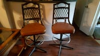 two brown leather padded bar stools Haltom City
