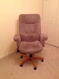 brown fabric padded rolling armchair 160 mi