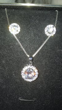 Rhinestone necklace with matching earrings set in sterling silver