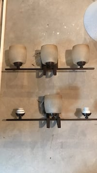 Set of two oil rubbed bronze finish bathroom fixtures. 25 inches wide, glass sconces can be replaced/purchased at Home Depot/Menards Plainfield, 60585