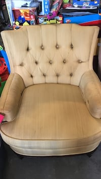 Tufted beige fabric sofa chair