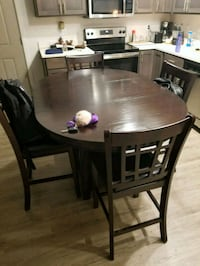round brown wooden table with four chairs dining set Liberty Lake, 99019