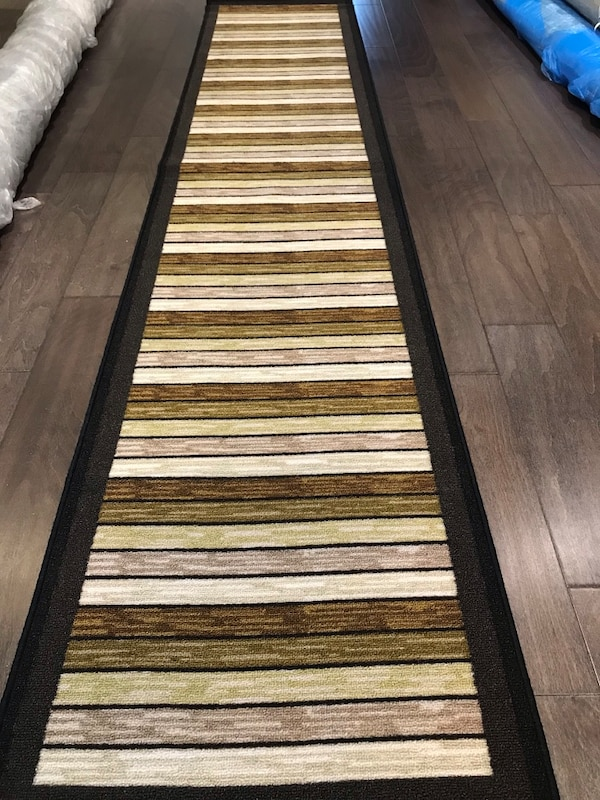 Brand new area rug 2x9.4