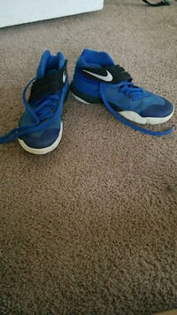 pair of blue-and-white Nike basketball shoes Bethany, 73008