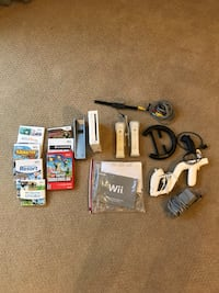 white Nintendo Wii console with controllers and game cases Rosemont, 21758