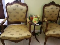 two brown wooden framed white floral padded armchairs Palm Bay, 32905