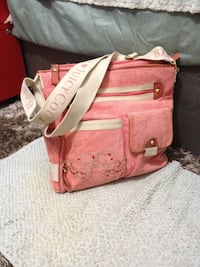 Plus pink Juicy Couture shoulder/cross body handbag. Great for office, school, casual outing, travel