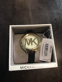 round silver Michael Kors analog watch with black strap
