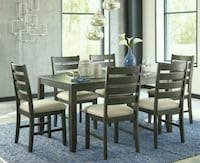 rectangular brown wooden table with six chairs dining set Houston, 77042